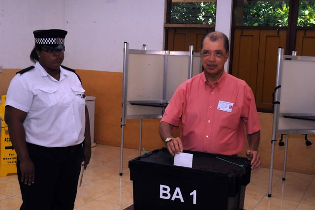 Incumbent President James Michel casts ballot in Seychelles' historic run-off presidential election