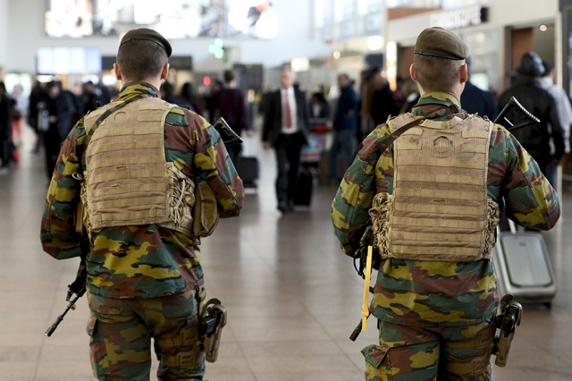 At least one dead as twin blasts rock Brussels airport