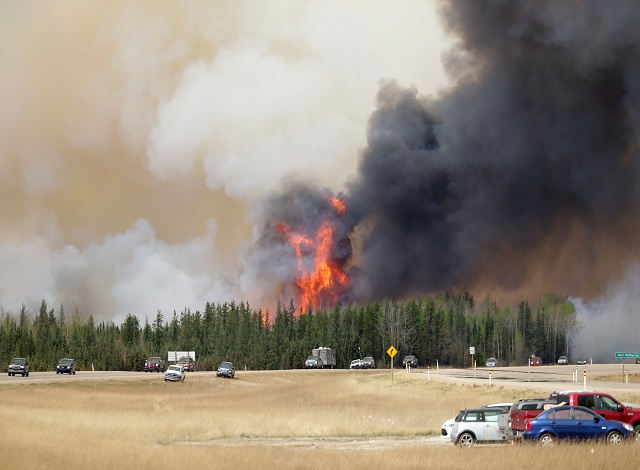 Canada oil output slashed due to Alberta wildfire
