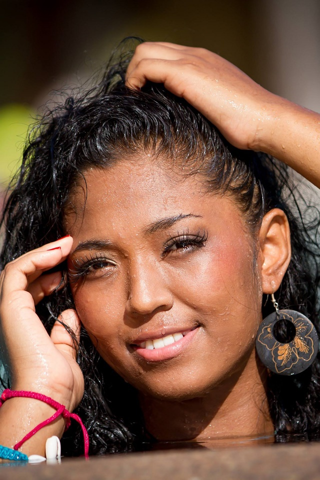 A shoulder to cry on: Miss Seychelles contestant Anais Nourrice shows concern for grieving children