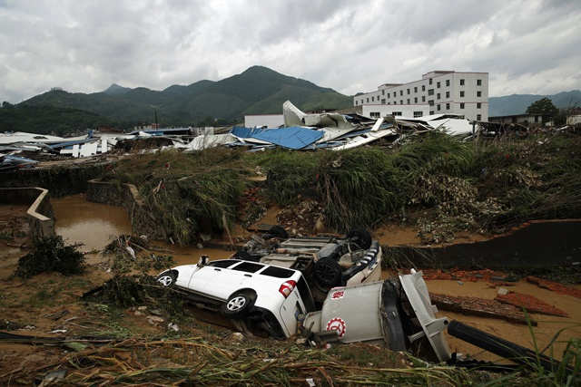 Tropical storm kills six in China, eight missing