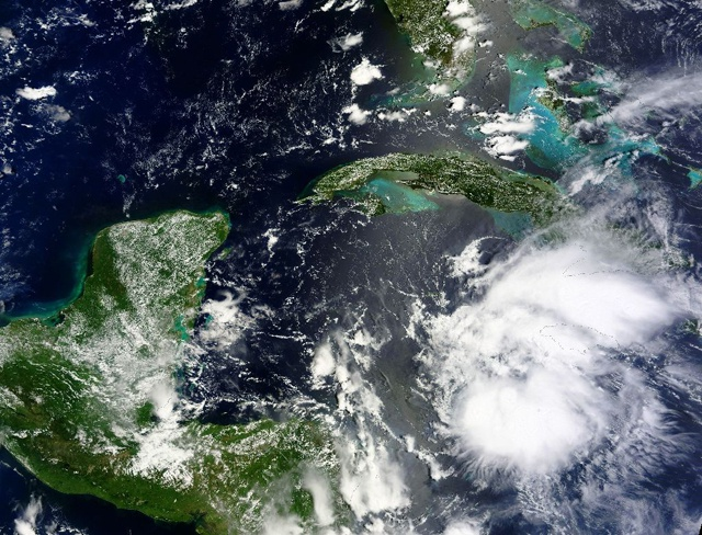 NHC says Earl weakening as it moves farther inland over Belize