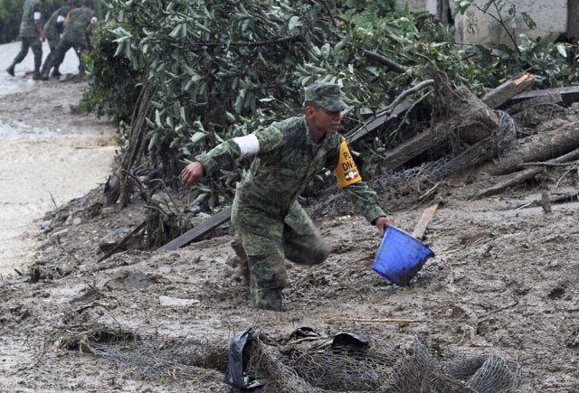 Mexico landslides leave 38 dead as new storm forms