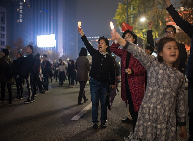 S. Korean scandal widens as two presidential aides arrested