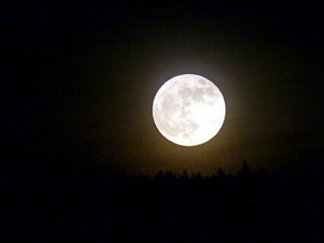 A supermoon delayed by clouds eventually shines on Seychelles