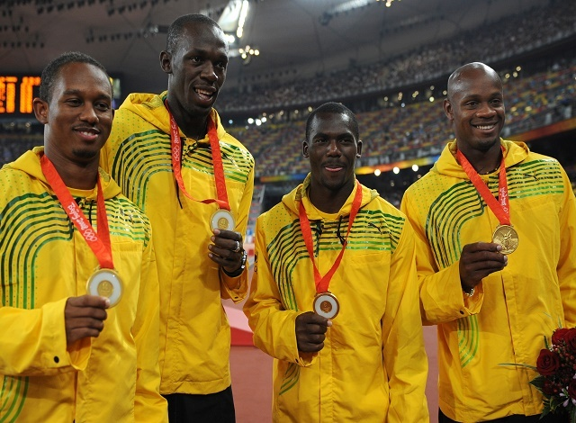 Bolt turns in medal, says 'rules are rules'