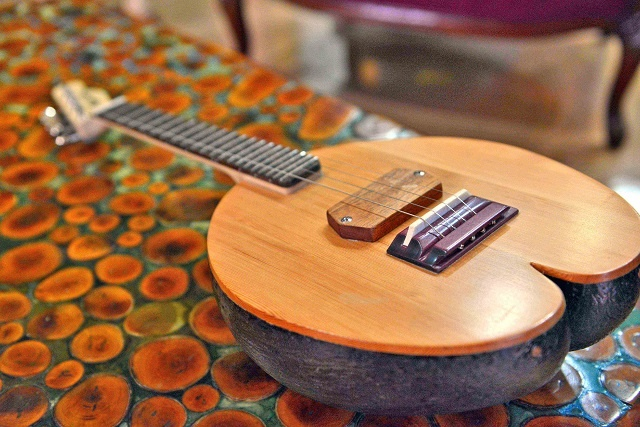 Six-string guitar made Seychelles style: carved by a coco de mer