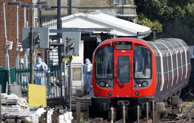 Manhunt for London bomber as threat level raised