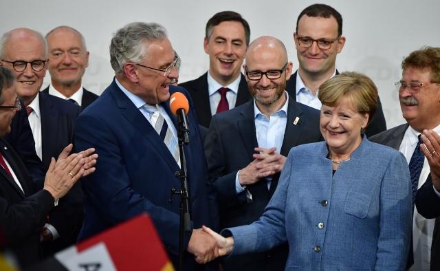 Weakened Merkel wins fourth term, hit by nationalist 'earthquake'