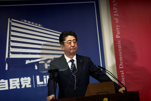 Abe aims at N. Korea after storming to 'super-majority' vote win