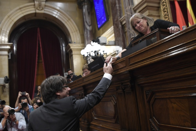 Spain readies to impose direct rule as Catalonia fights back