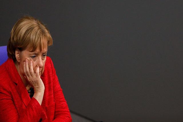 L'Allemagne cherche une sortie de crise avec Merkel à la barre