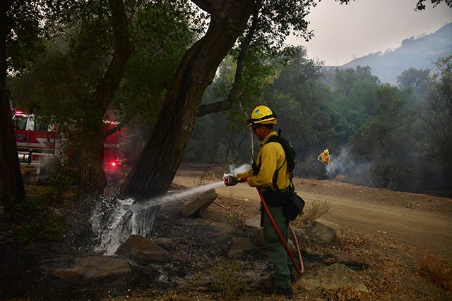 Winds whip California fires as they spread south