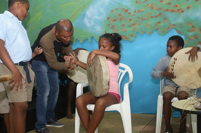 Musician in Seychelles working with students to maintain island drumming traditions