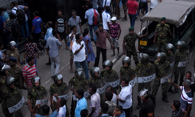 Pressure mounts on Sri Lankan president as crisis turns violent