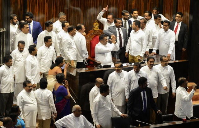 Sacked Sri Lanka PM seeks job back after parliament riot