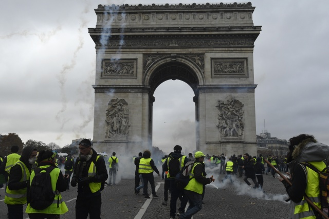 Police fire tear gas and water cannons to disperse protesters in Paris