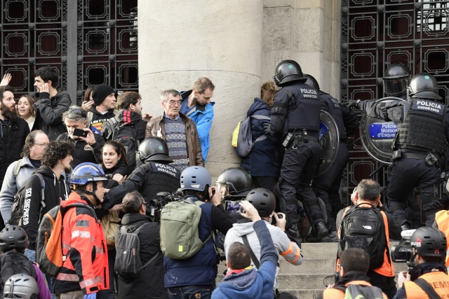 Protesters clash with police as Spain cabinet meets in Catalonia