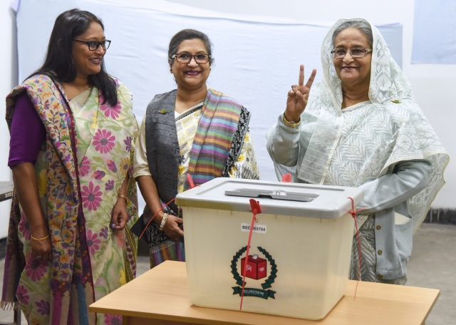 Bangladesh PM wins election landslide as opponents demand new vote