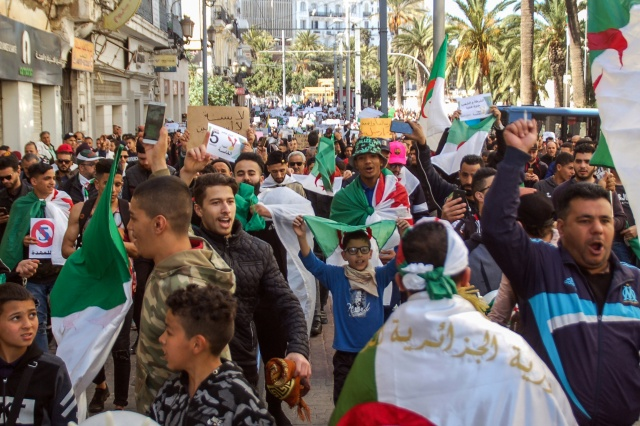 Tens of thousands protest in Algeria as Bouteflika stays defiant