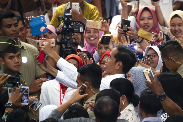 Indonesian leader points to reelection victory as rival rejects results