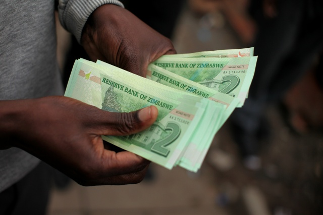 Zimbabwe ends foreign currency use as inflation spirals