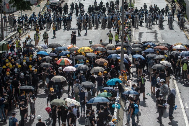 Hong Kong braces for mass rally on China handover anniversary