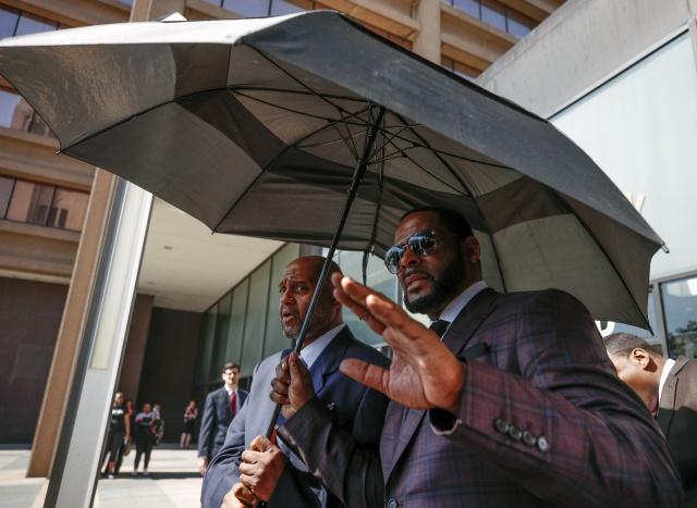 R. Kelly arrested on child pornography, other charges