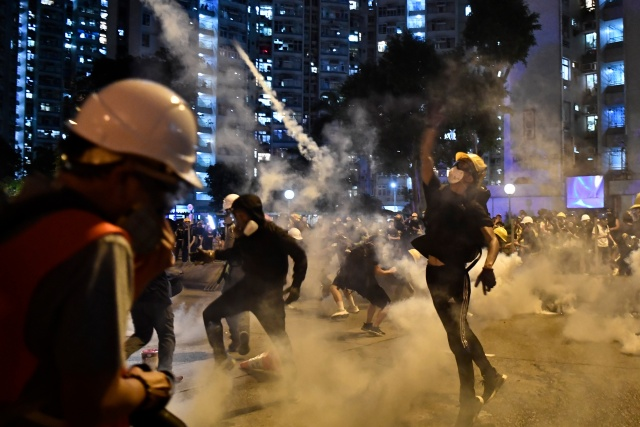 China warns Hong Kong protesters of 'immense strength' of government