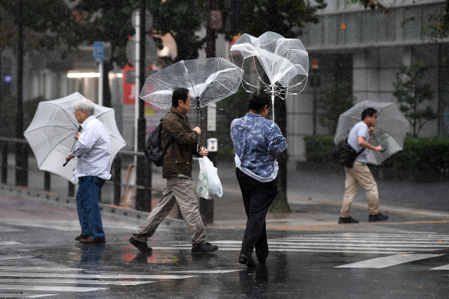 One dead as Typhoon Hagibis takes aim at Japan