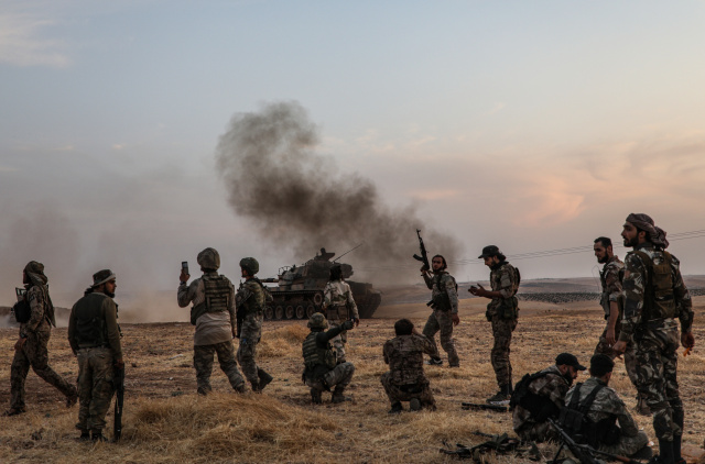 Syria Kurds defend key town as Turkey ignores US