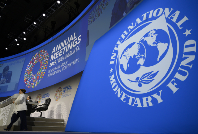 IMF members put off voting change; agree to boost lending capacity