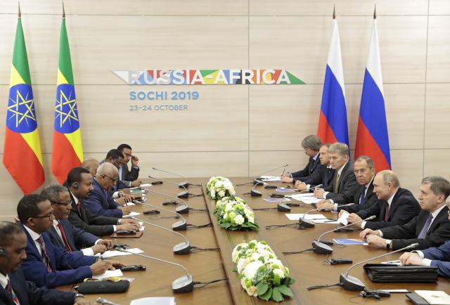 As Kremlin scrambles for Africa, Putin praises ties at major summit