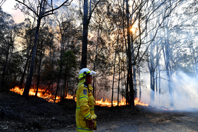 Two dead, at least 150 homes lost in Australia bushfires