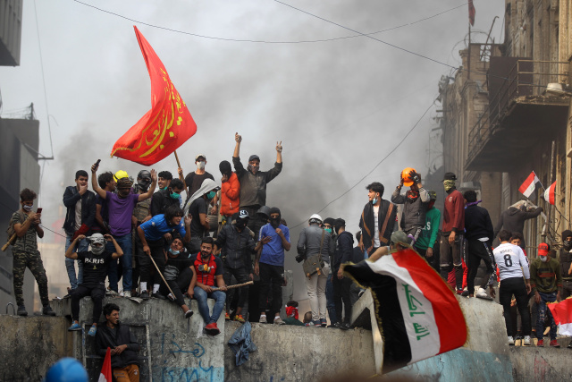 Iraqis keep up anti-regime demos despite PM's vow to quit