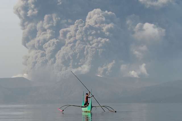 Philippines on alert as volcano spews ash, lava