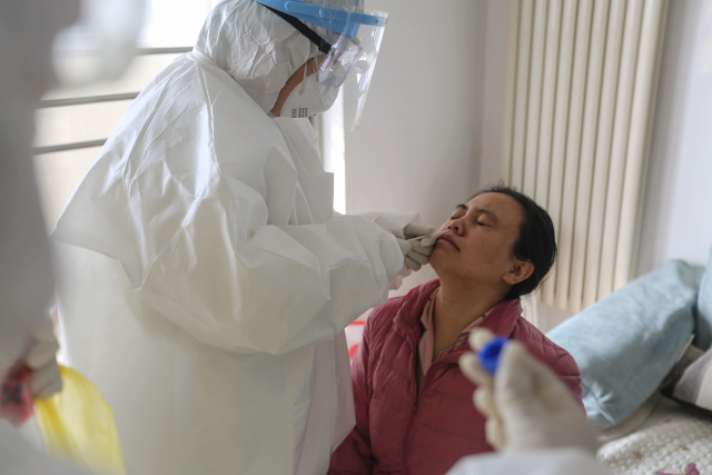 China's new virus cases fall again, deaths now exceed 1100