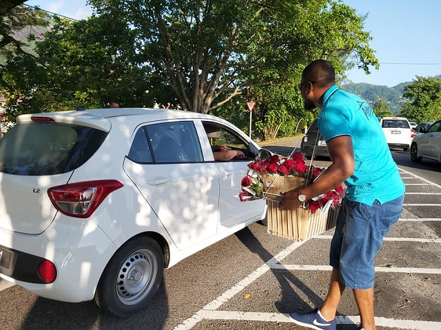 A Valentine's Day rose give-away in the streets of Seychelles spreads love, cheer