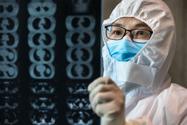 New virus outbreaks in China and abroad rekindle concerns