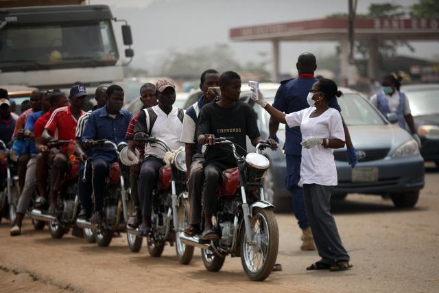 Millions of Nigerians enter lockdown as Africa tries to halt virus