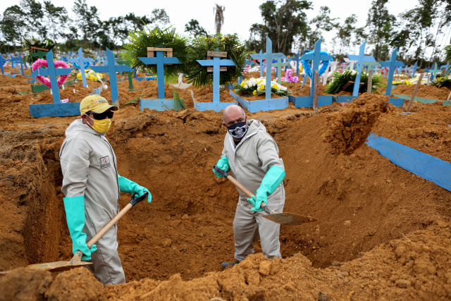WHO warns virus may be here to stay as toll nears 300,000
