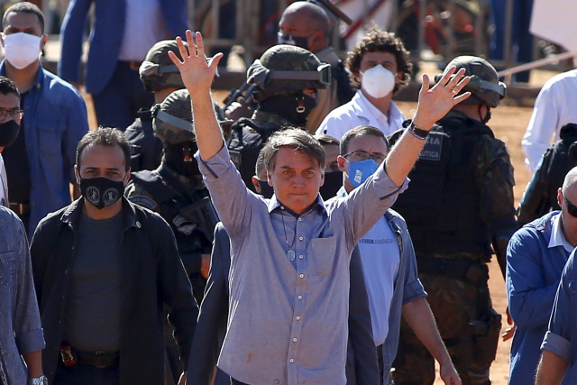 Brazil's president contracts virus as US starts WHO withdrawal