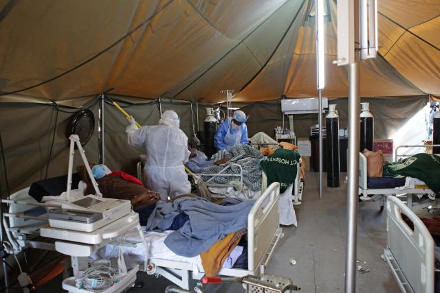 Virus surge sparks SAfrica curfew and Spain local lockdown