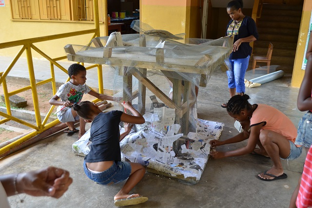 Children in Seychelles creating artwork to raise awareness on reef protection