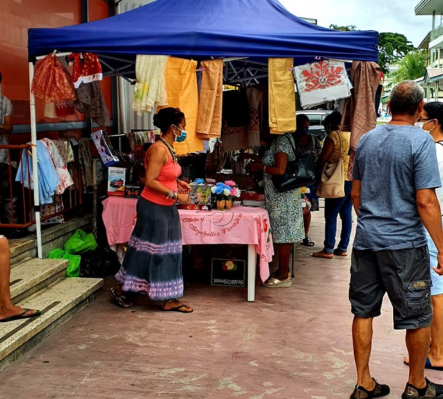 Shoppers flock to Seychelles' capital for last-minute gifts, but feel squeezed by rupee's devaluation