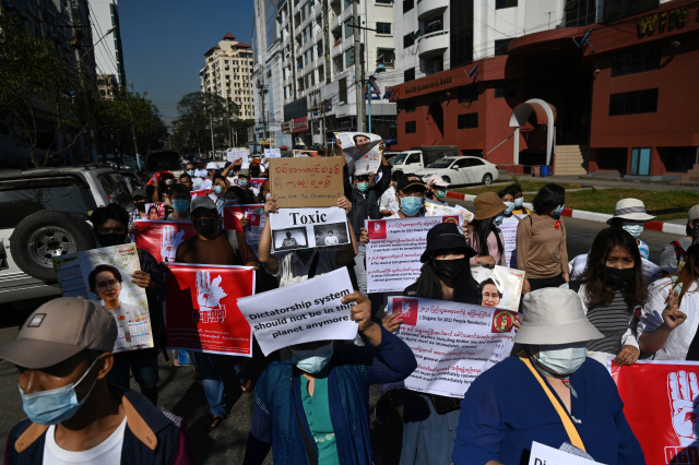 Myanmar anti-coup protesters march again as US sanctions generals