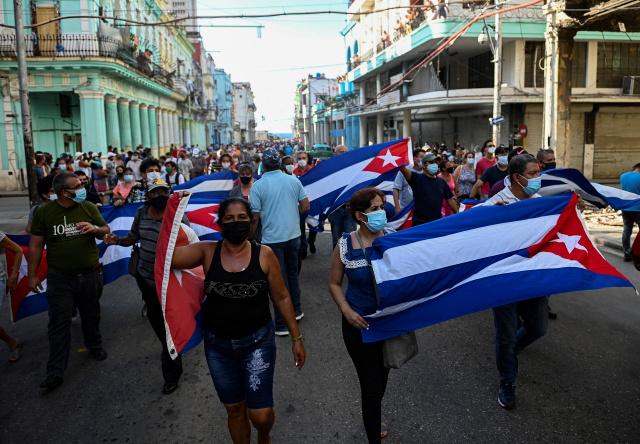 One Cuban dead, dozens arrested after unprecedented protests