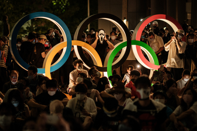 Crowds gather outside Tokyo stadium for Olympics opening ceremony