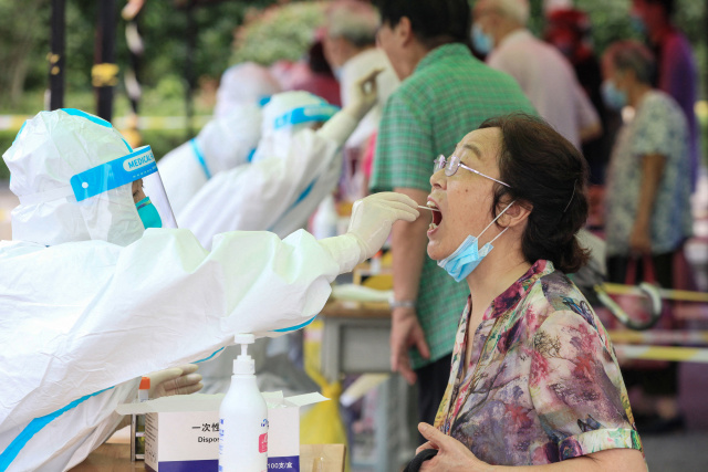 China battles biggest Covid outbreak in months as US ramps up vaccine push
