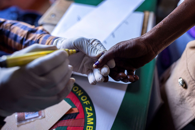 Debt-ridden Zambia votes in closely contested polls
